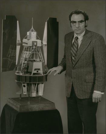 Dr. Freden with a model of Landsat 1 (1972).