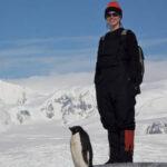 Scientist and penguin